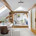 Cozy Attic Bachelor Pad with Original Wood Beams