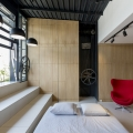 Rooftop Apartment with Hidden Functional Service Spaces and Movable Bed