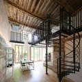 An Old Workshop Transformed into a Double Height Residence with Mezzanines