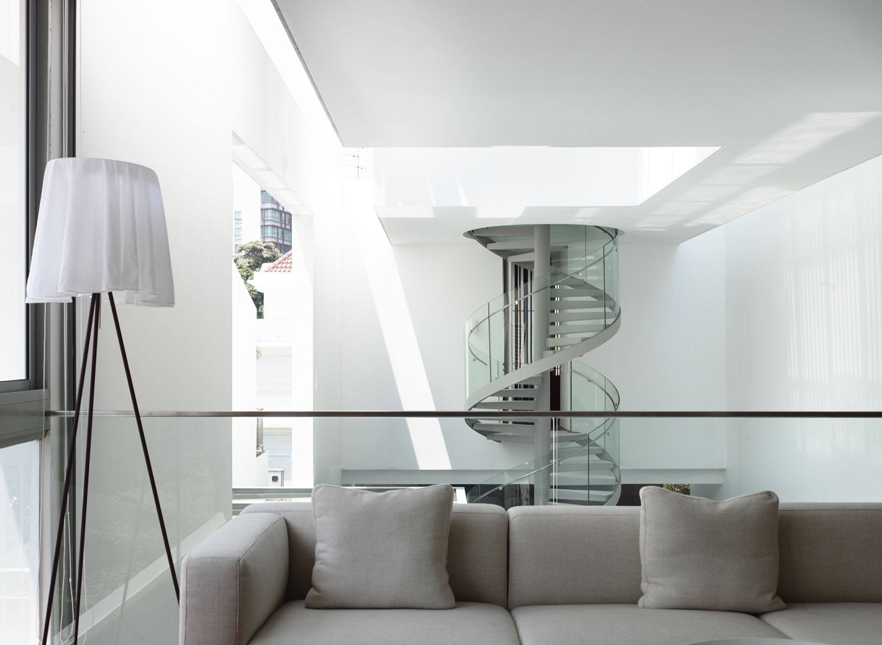sleek modern home in singapore with glass bridge over pool