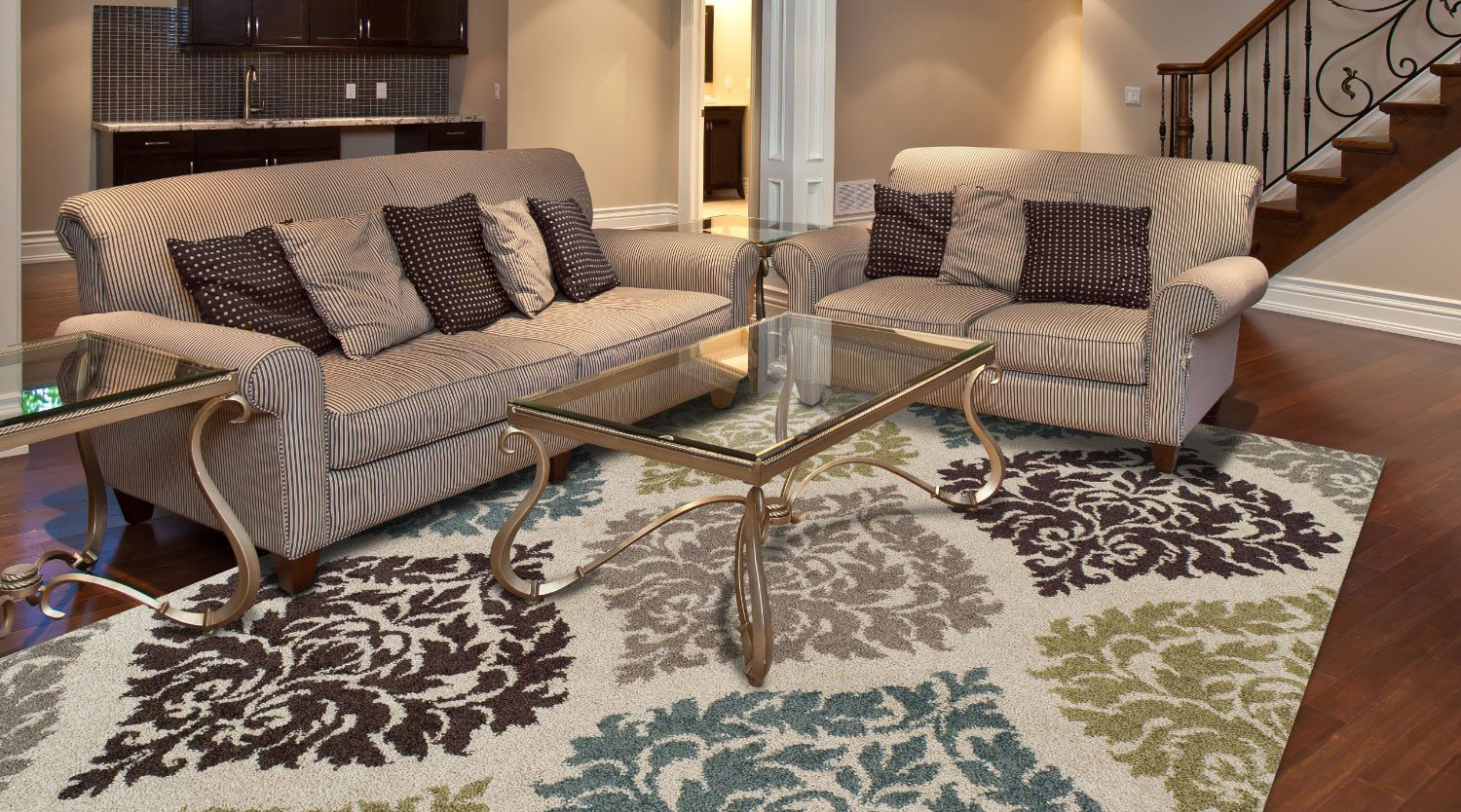 decorating your living room with a rug create a sense of elegance for