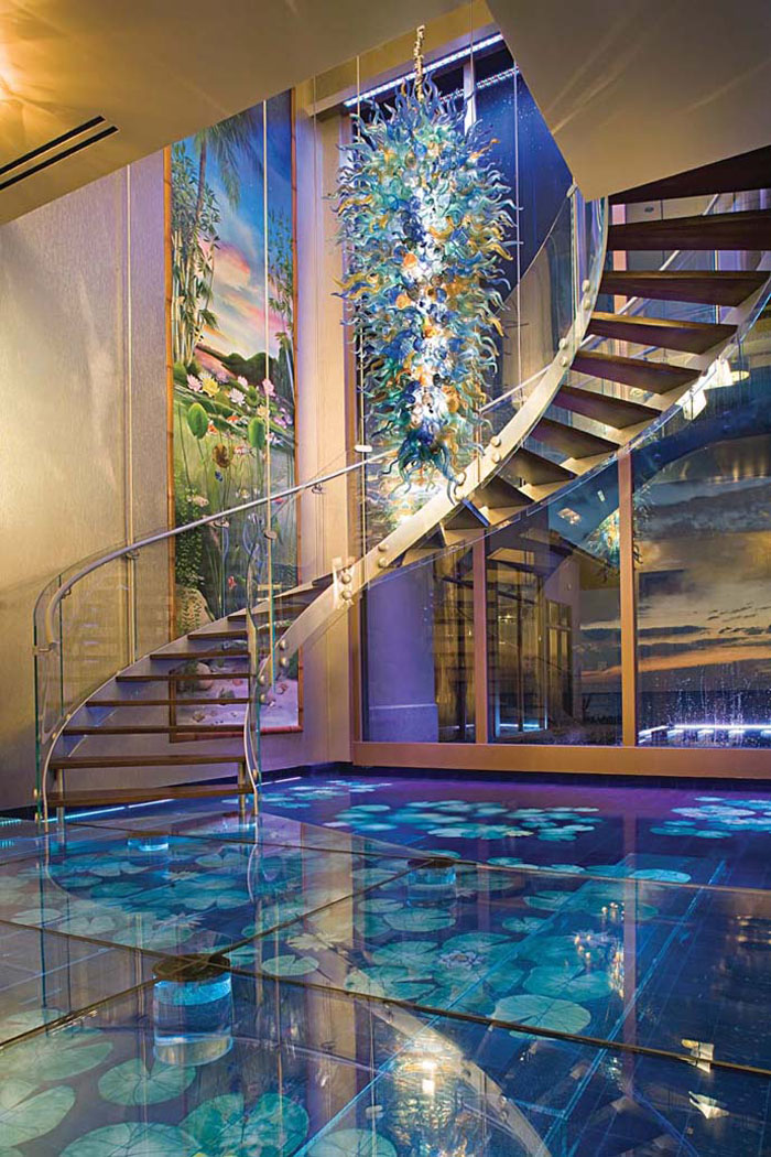 Double helix glass spiral staircase and hand-blown glass chandelier