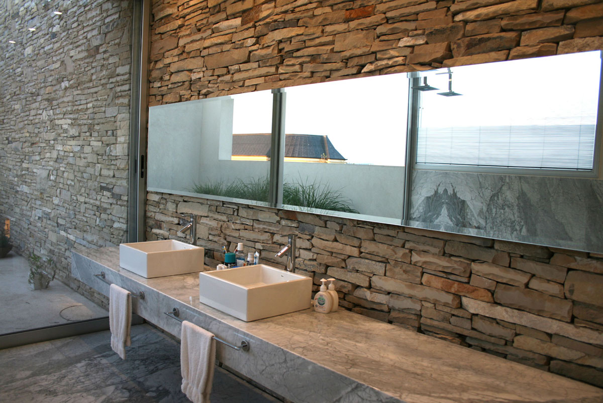 Modern stone wall house with water elements idesignarch for Modern stone houses architecture