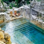 Natural Backyard Swimming Pool Converted from an Old Limestone Quarry