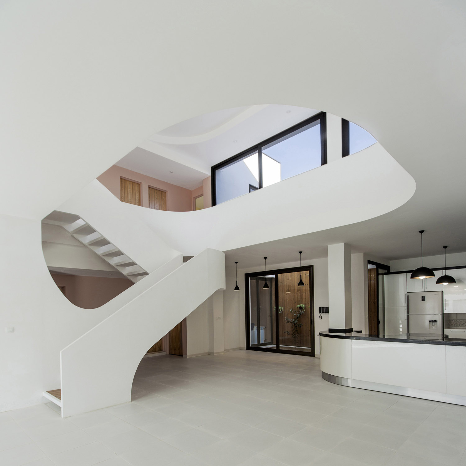 White modern house with curved surfaces in isfahan stands for House inside arch design