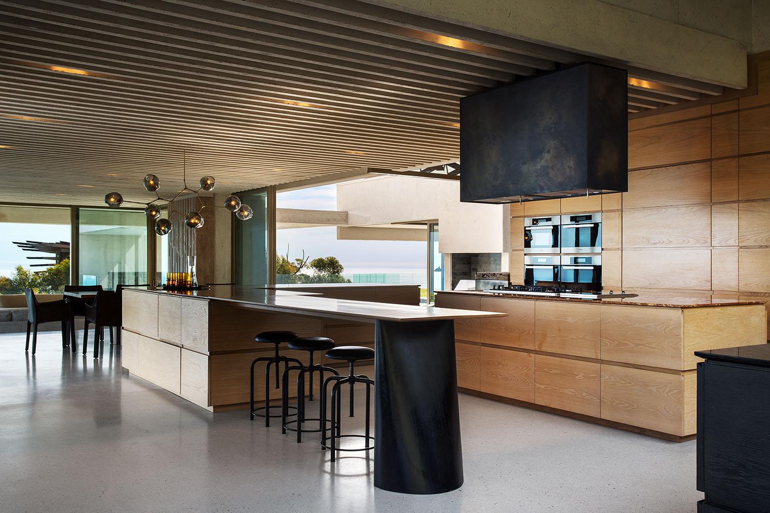 Contemporary ridgetop house with ocean and mountain views