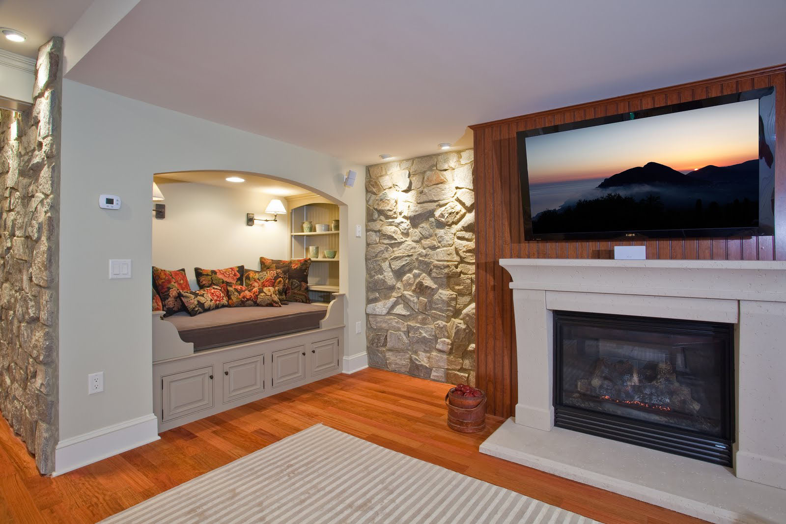 Residential Basement With Stone Walls. Sleeping Alcove In Basement