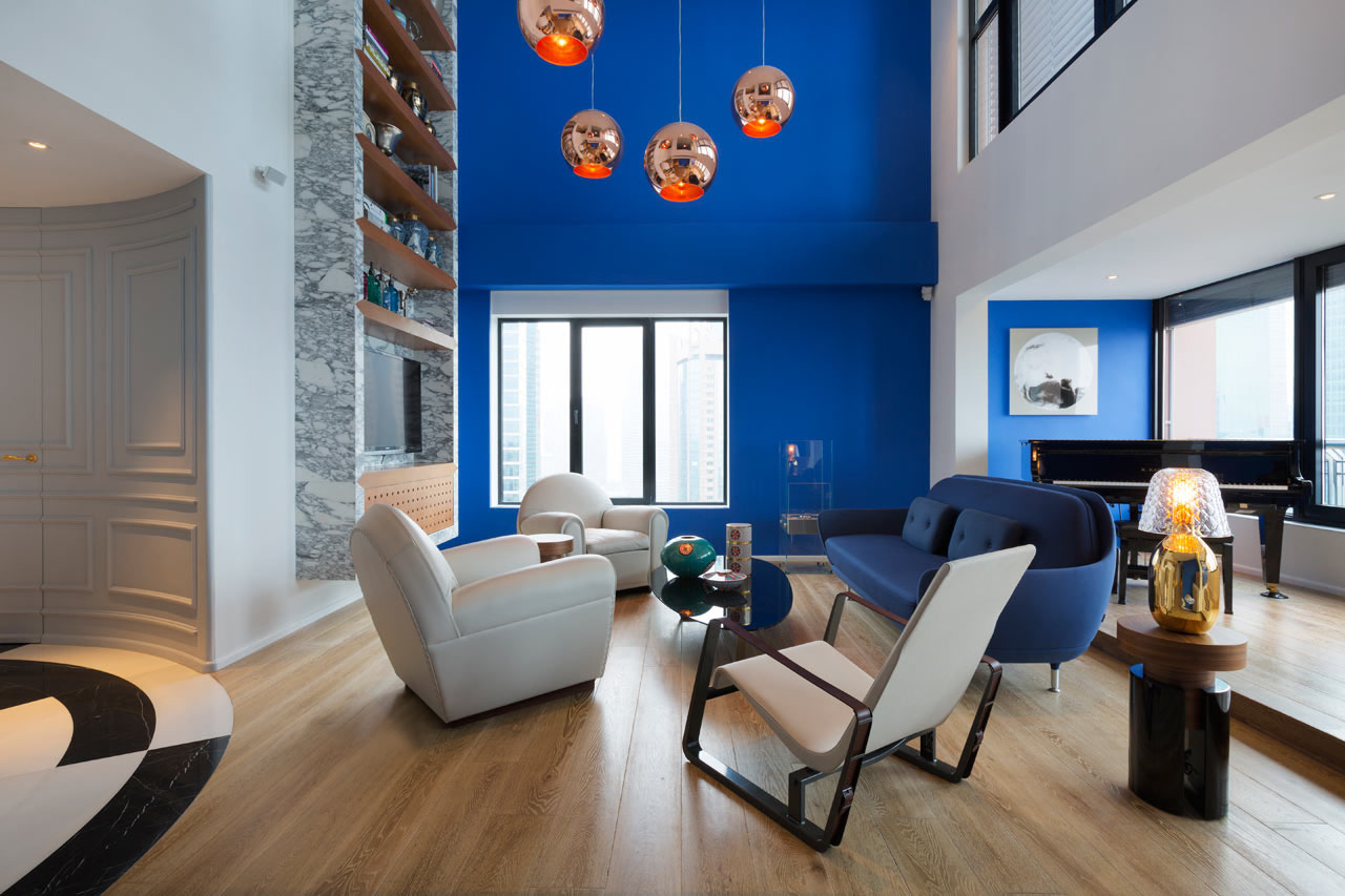 Unique Modern Penthouse with Blue Wall