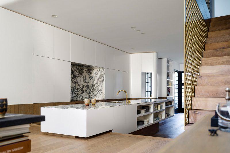 Modern White Kitchen with Carrara Marble Countertop and Backsplash