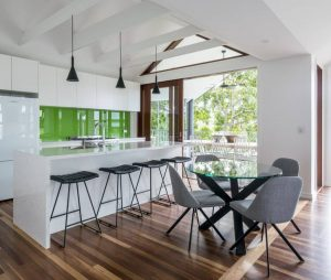 Modern Renovated White Kitchen with Green Backsplash