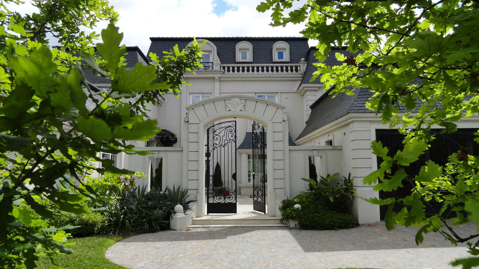 Classic parisian style mansion in argentina idesignarch for Luxury home architects
