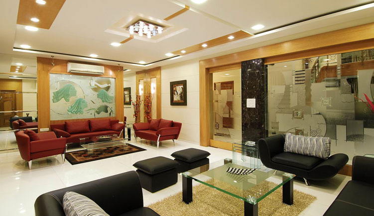 Contemporary bungalow in india with a touch of traditional Bungalow living room design