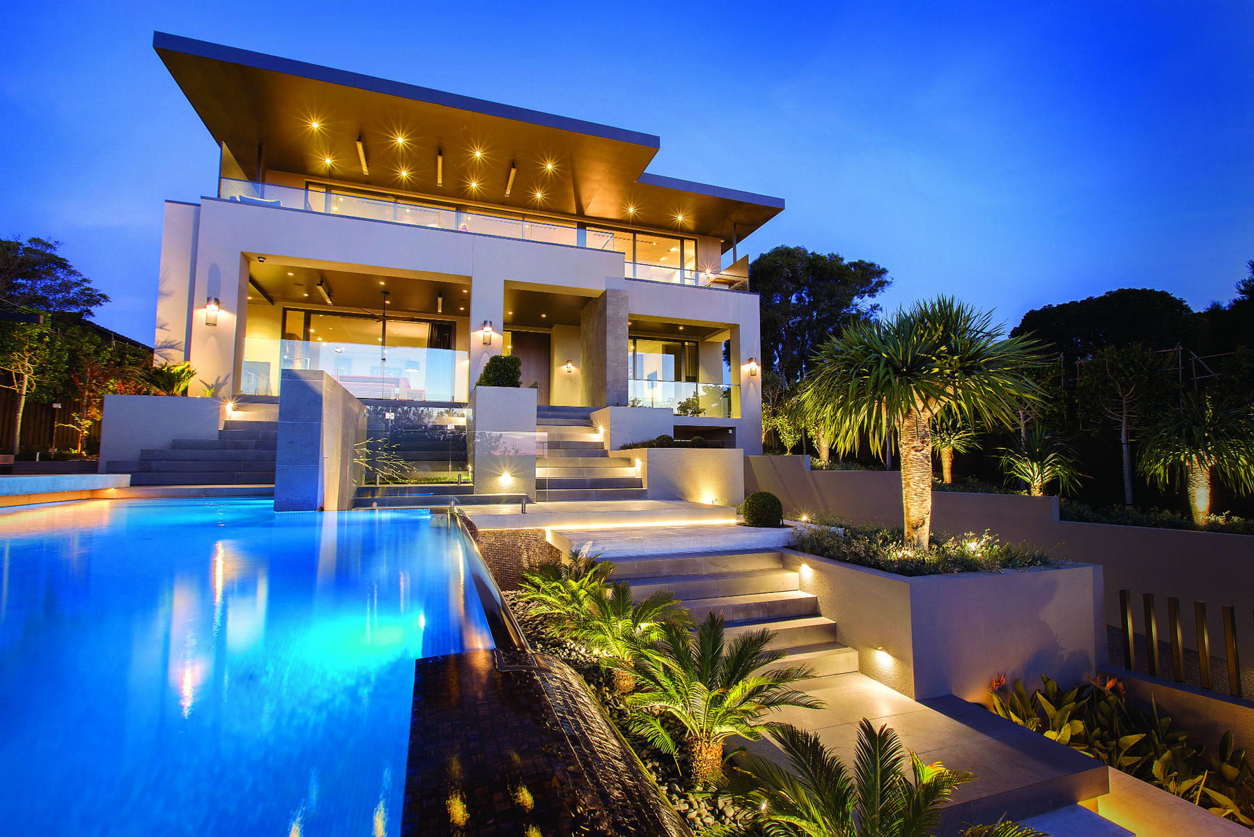 Luxury contemporary home with front yard pool