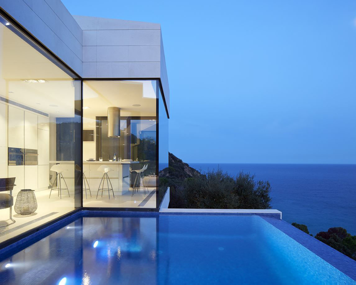 Modern hillside coastal home in spain with magnificent for Modern house design on hillside