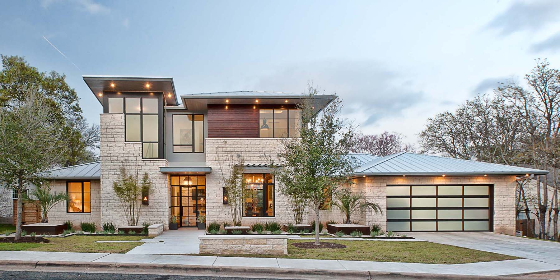 A contemporary home with rustic elements connects to its for Rustic contemporary home plans