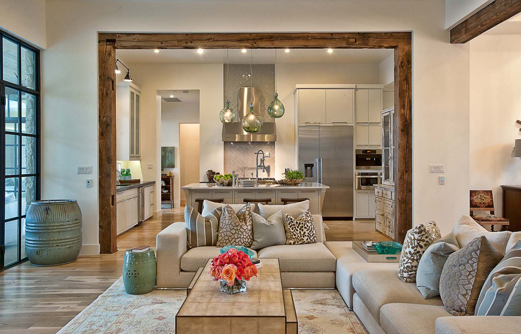 A contemporary home with rustic elements connects to its for Homeinteriors com texas