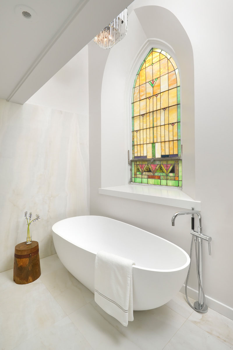 Modern bathroom with stained glass window