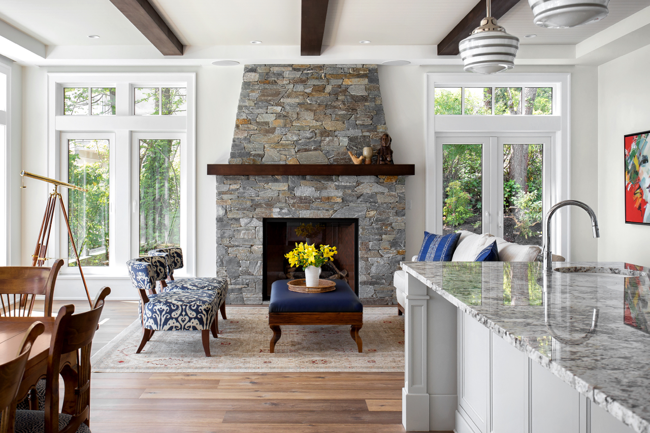 Classic french country style waterfront custom home in for French country stone fireplace