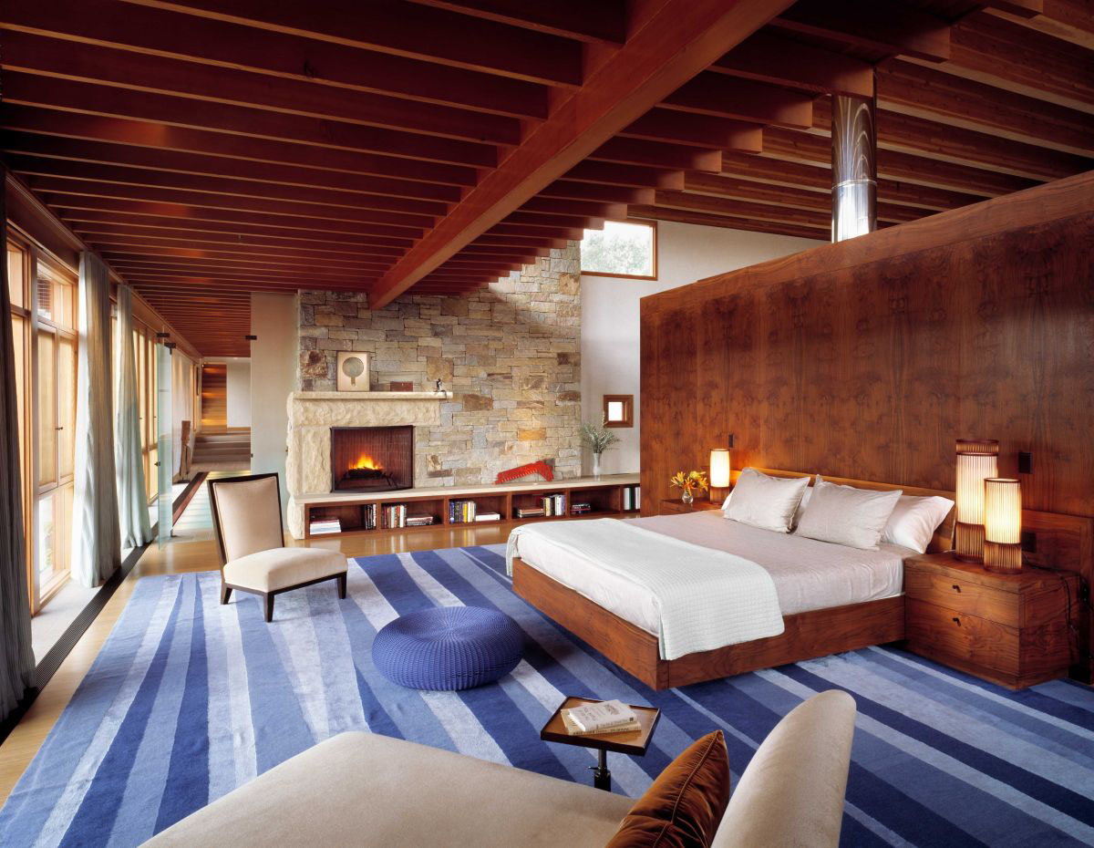 Bedroom with Wood Beams and Stone Wall
