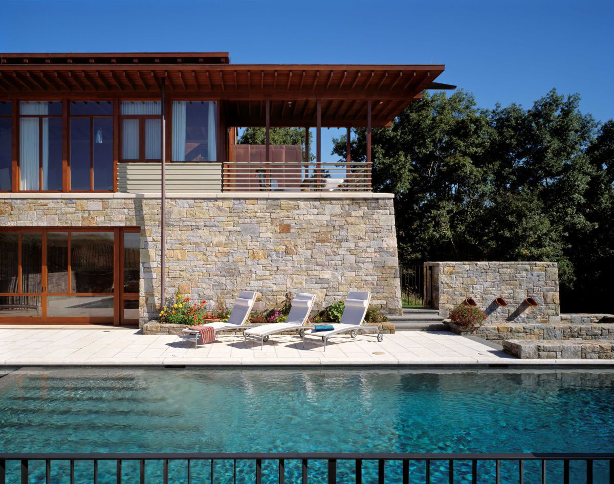 Beautiful stone and wood house with indoor swimming pool for Modern wood house