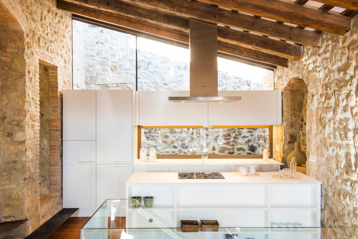 Modern Kitchen with Stone Walls