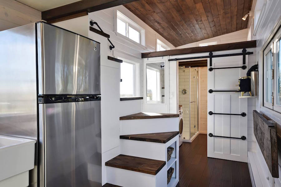 tiny house with staircase and full size fridge