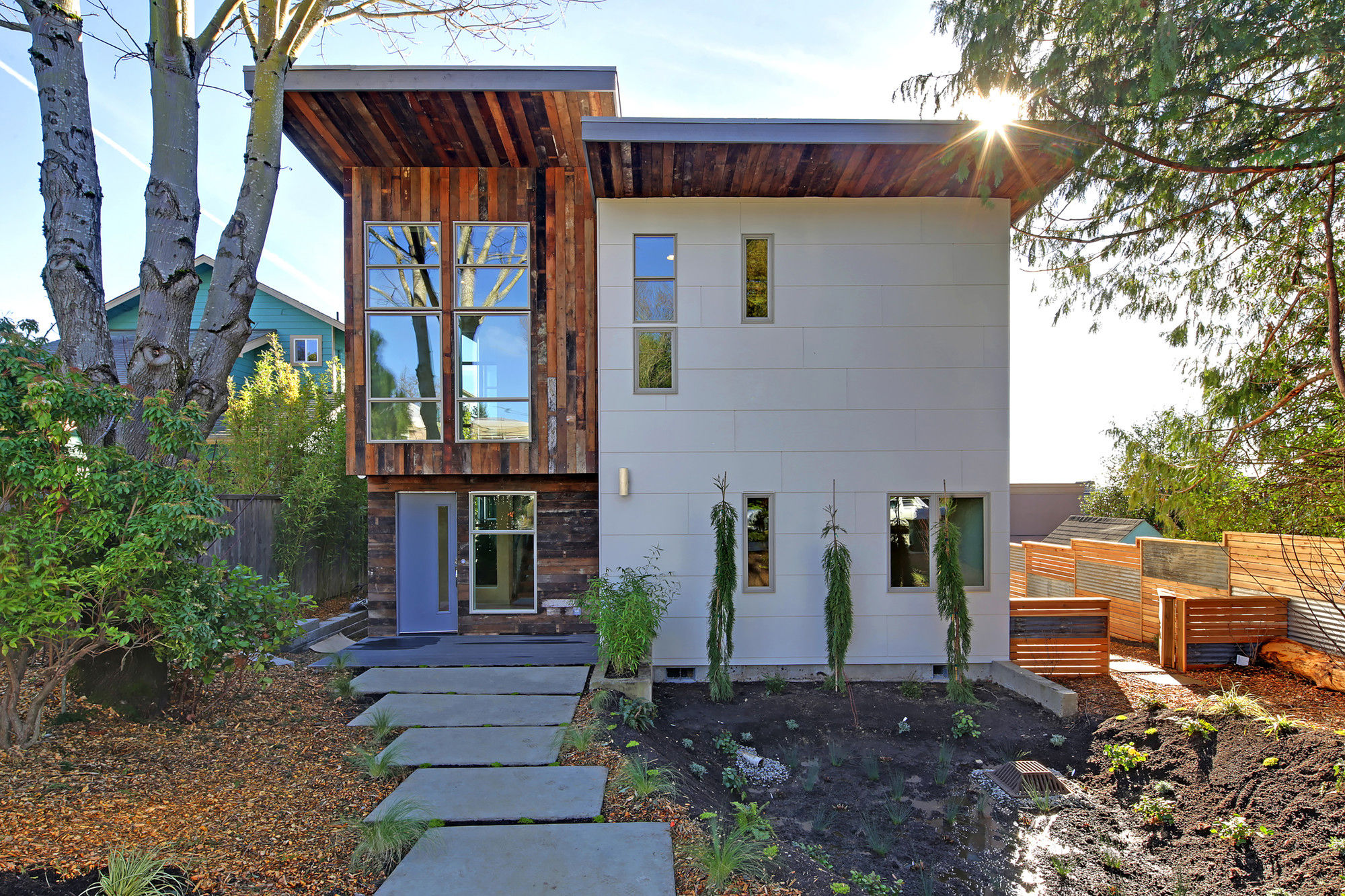 environmentally conscious home features exterior siding with