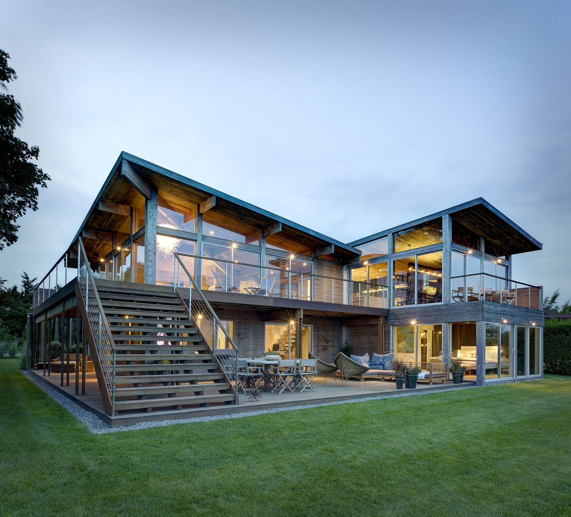 Hurricane proof wood and steel waterfront home on long for Beach architecture design