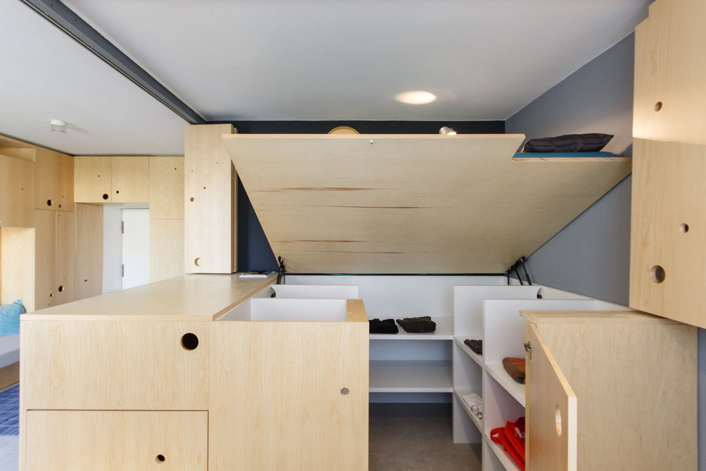 Small Studio Apartment With A Clever Movable Partition System