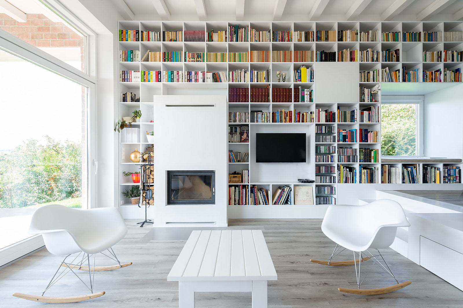 minimalist house with a long wall of books idesignarch. Black Bedroom Furniture Sets. Home Design Ideas