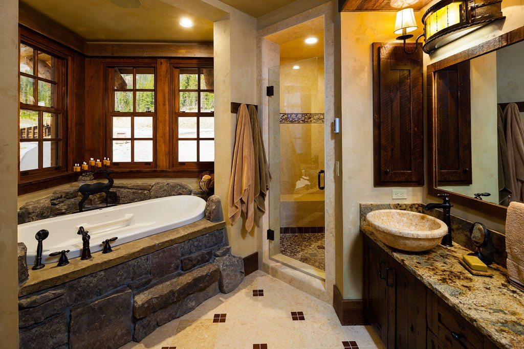 Old west inspired luxury rustic log cabin in big sky for Log home bathroom ideas