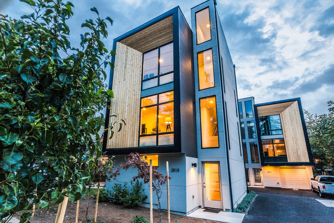 Modern prefab modular townhouses designed for urban living for Townhouse architecture designs