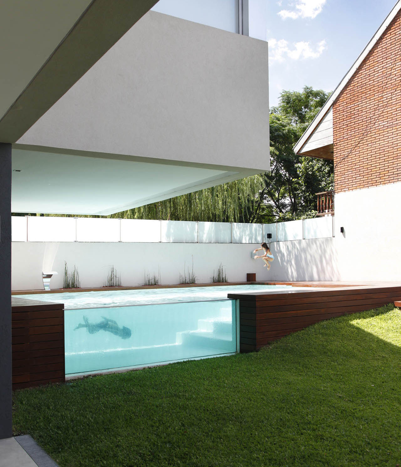 Swimming Pool Houses Designs louvered pool The Innovative Design Of This House