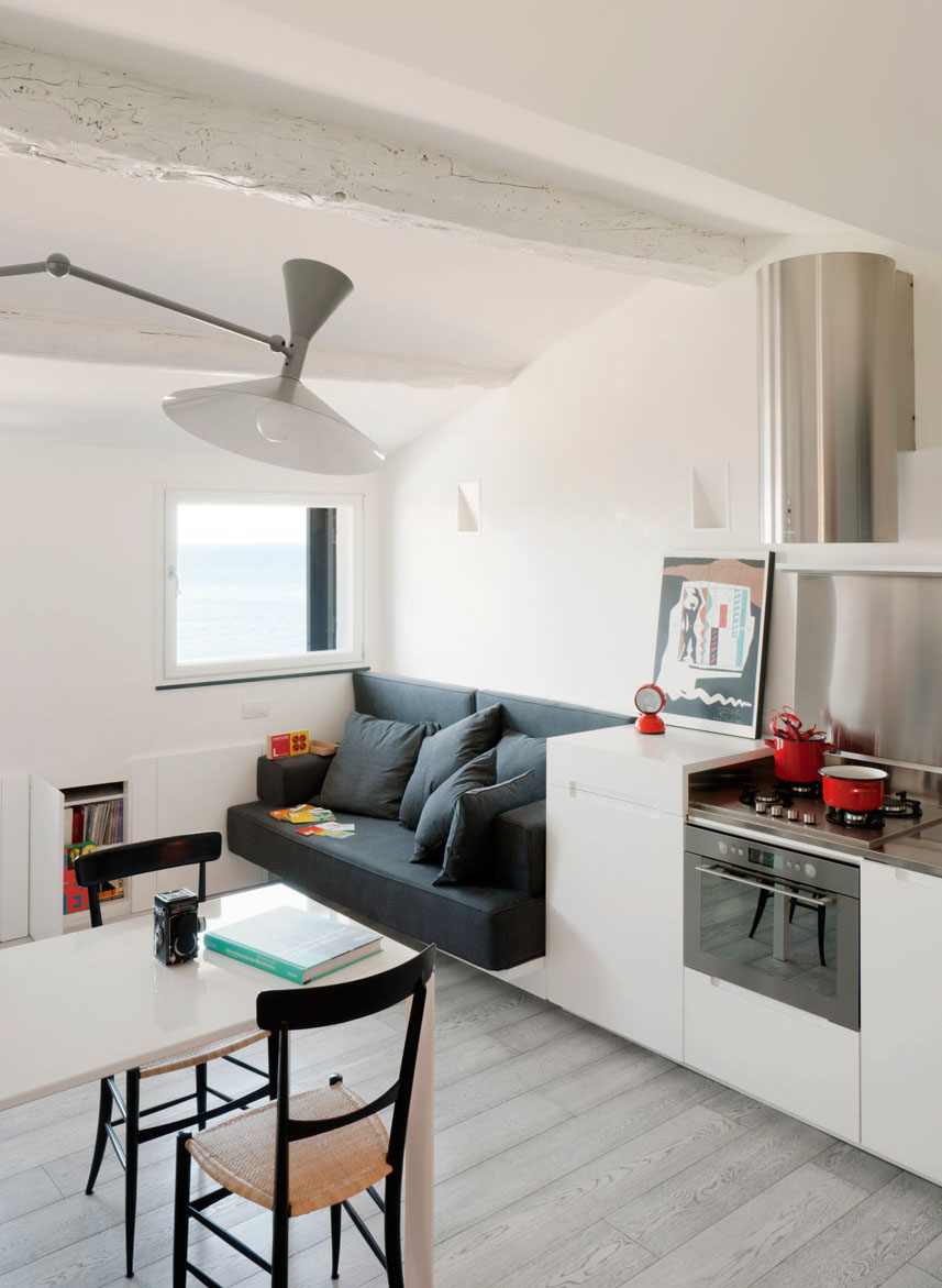 Small modern attic apartment with harbour view - Living room with small space ...