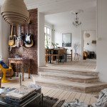 Stylishly Renovated Modern Apartment With Wooden Floor And Decorative Brick Walls