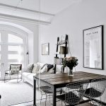 Chic Studio Apartment Divides Space With Glass Partition