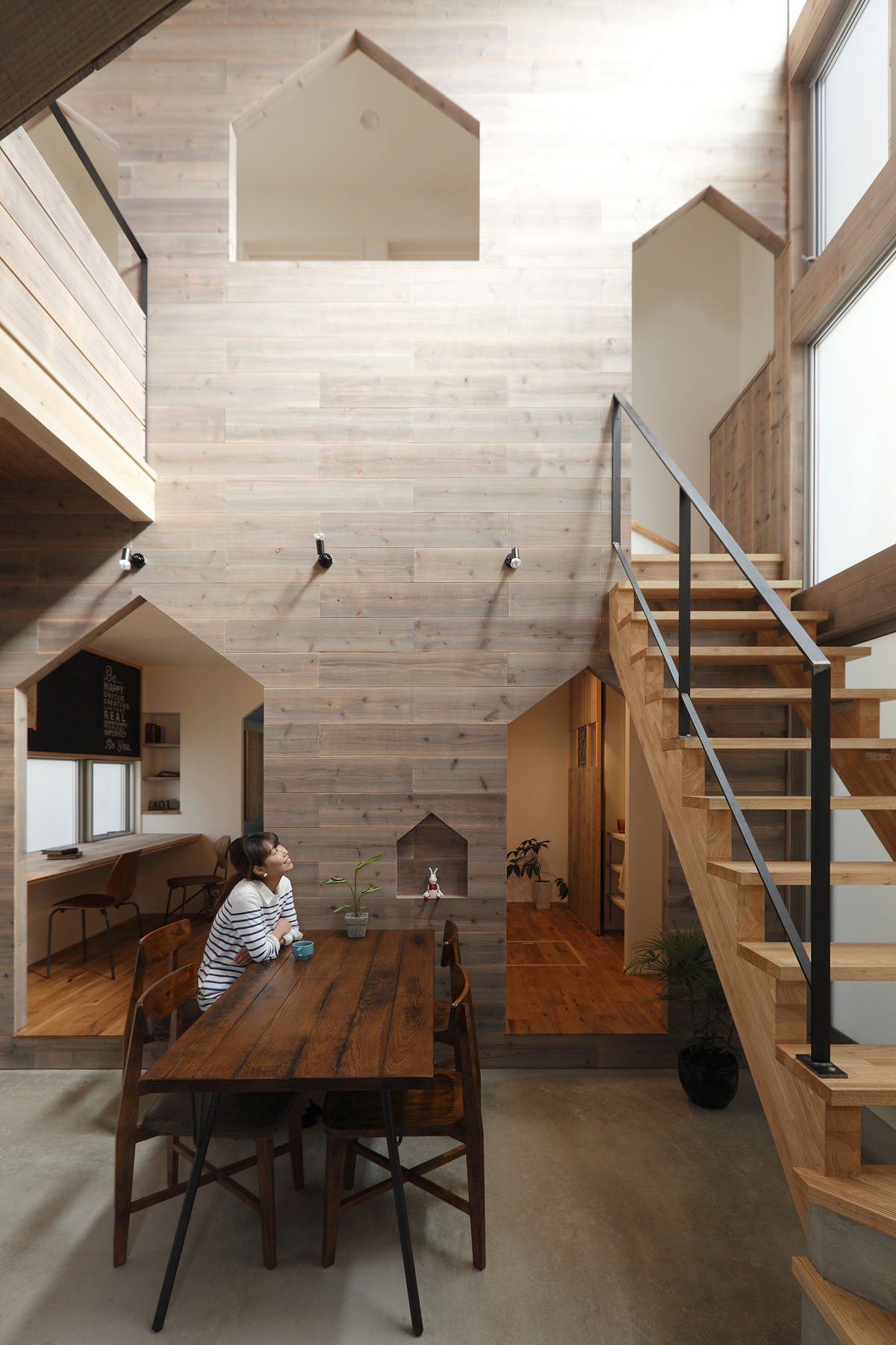 Small modern house in kyoto with wood interiors for Modern japanese house interior design