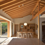 Timber-Framed Japanese House Built Around Private Gardens
