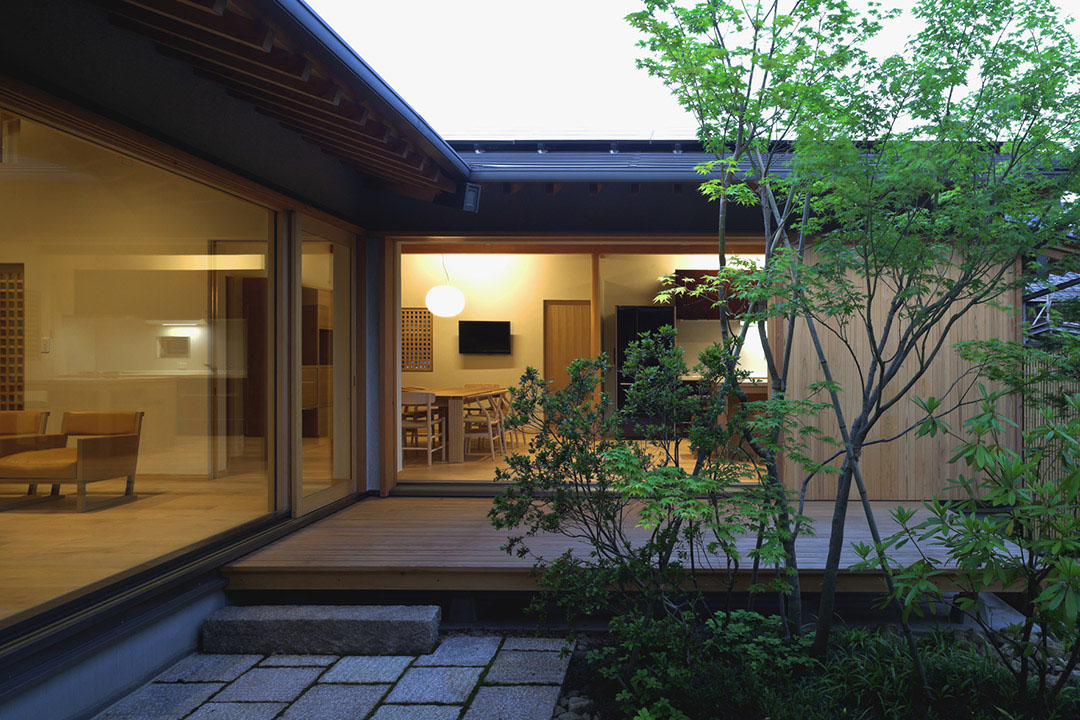 Timber framed japanese house built around private gardens for Japanese house garden