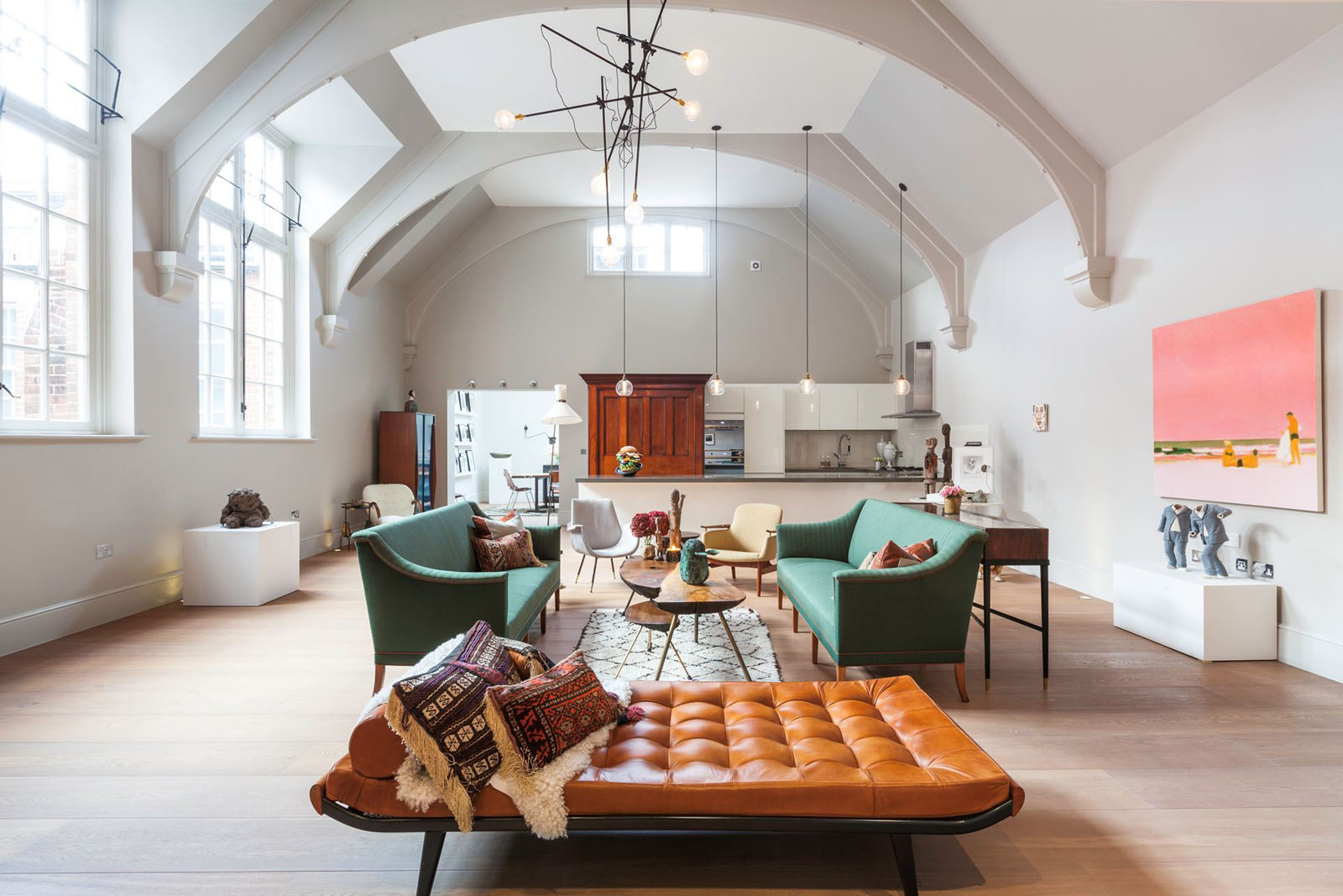 1900s courthouse with dramatic vaulted ceiling transformed for Interior design firms london