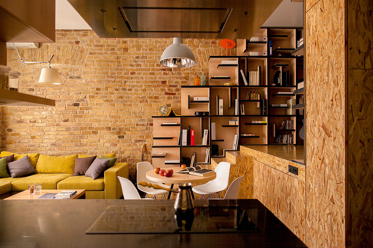 Apartment with Brick Wall and Wood Shelves