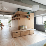 L-Shaped Wood Partition Unifies All Areas In Small Practical Apartment