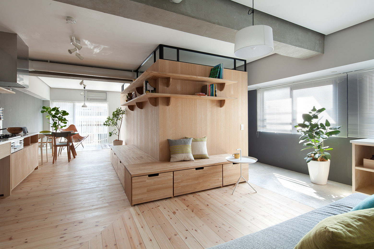 l-shaped wood partition unifies all areas in small practical