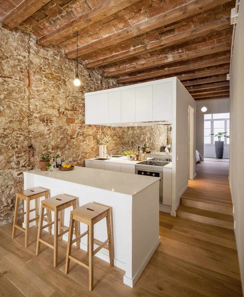Modern White Apartment With Rustic Stone Wall