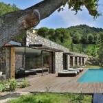 Modern Italian Stone Villa On A Hill Overlooking The Ligurian Landscape And The Sea