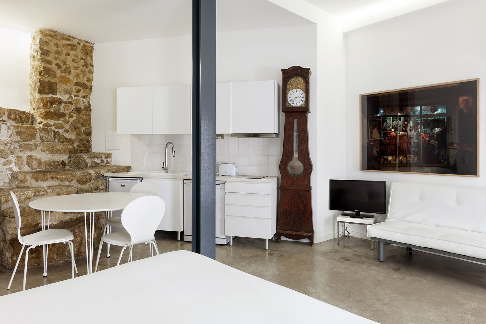 Studio Apartment with Stone Wall