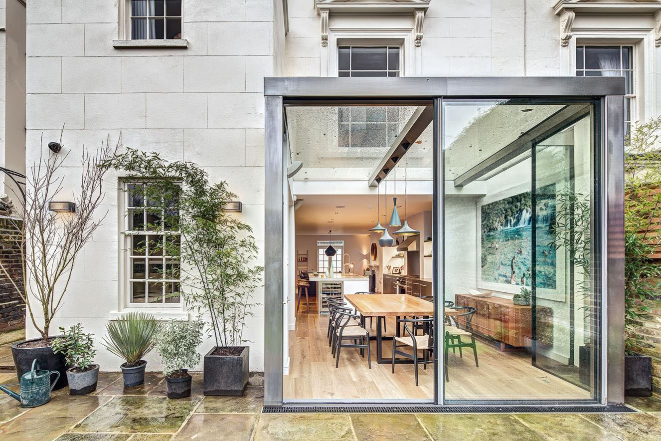 Modern steel and glass rear extension of a victorian semi for Modern architecture house london