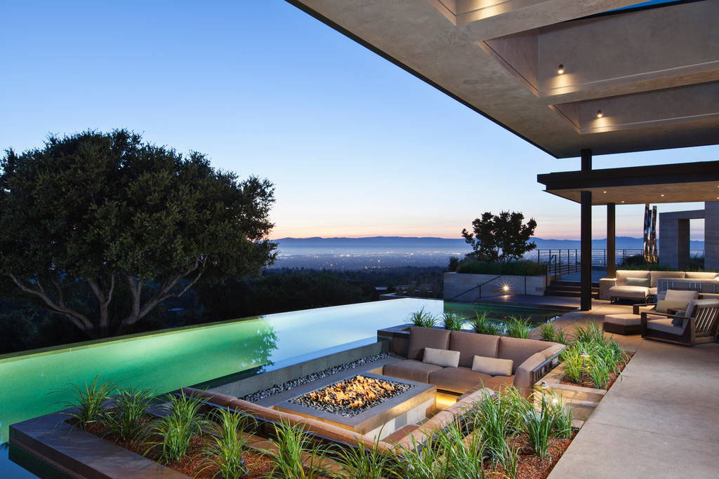 Outdoor entertaining space with fire pit and swimming pool