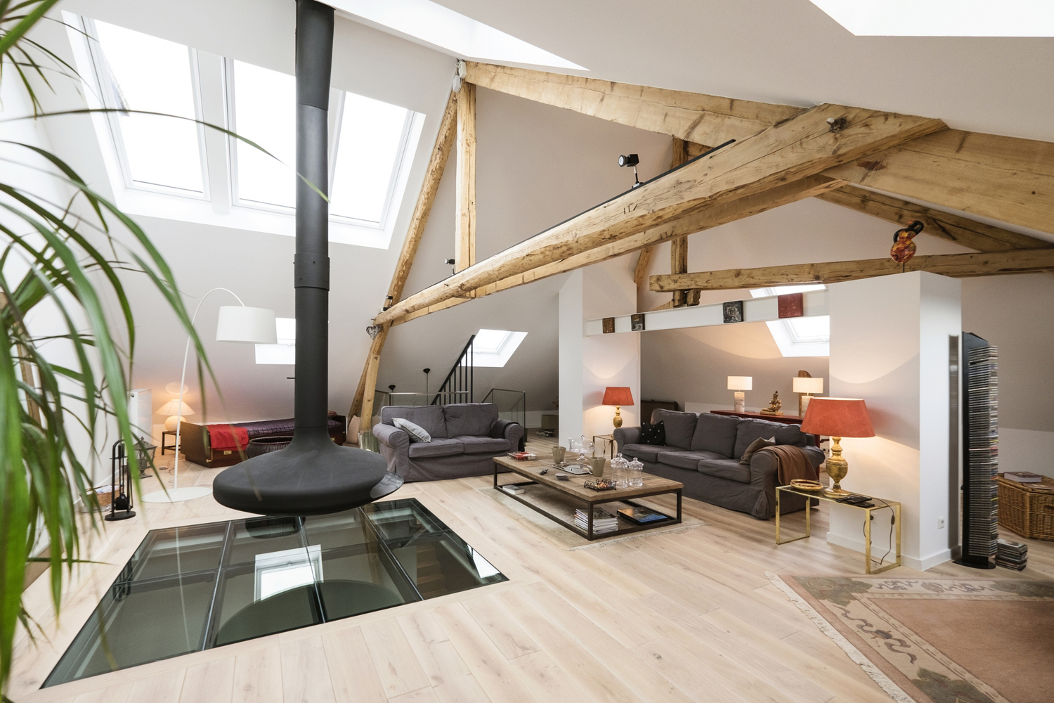 Living room with oak flooring and exposed wood beams