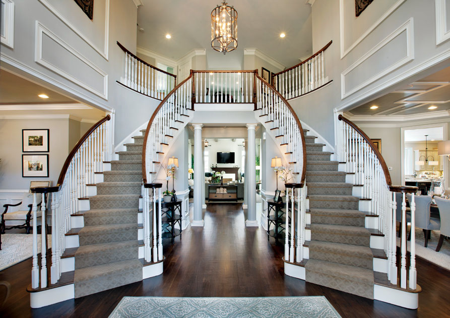 Luxury home elegant curved staircases for Luxury staircase